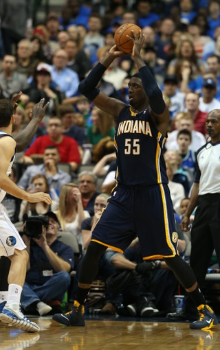 Mar 9, 2014; Dallas, TX, USA; Indiana Pacers center Roy Hibbert (55) with the ball in the post against the Dallas Mavericks at American Airlines Center. The Mavs beat the Pacers 105-94. Mandatory Credit: Matthew Emmons-USA TODAY Sports