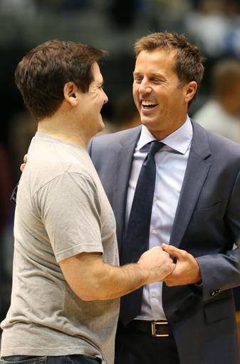 Mar 9, 2014; Dallas, TX, USA; Dallas Mavericks owner Mark Cuban (left) with Dallas Stars former player Mike Modano at a half time ceremony during the game against the Indiana Pacers at American Airlines Center. The Mavs beat the Pacers 105-94.  Mandatory Credit: Matthew Emmons-USA TODAY Sports