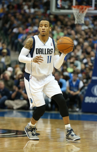 Mar 9, 2014; Dallas, TX, USA; Dallas Mavericks guard Monta Ellis (11) dribbles against the Indiana Pacers at American Airlines Center. The Mavs beat the Pacers 105-94. Mandatory Credit: Matthew Emmons-USA TODAY Sports