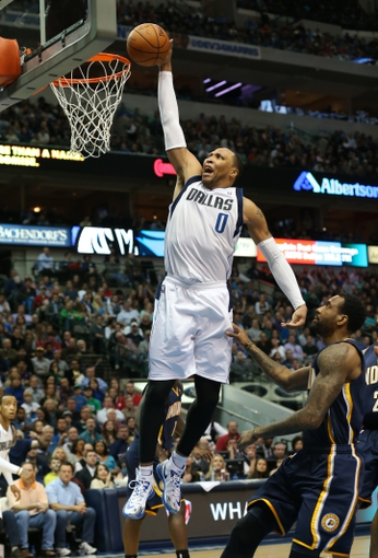 Mar 9, 2014; Dallas, TX, USA; Dallas Mavericks forward Shawn Marion (0) attempts a dunk against the Indiana Pacers at American Airlines Center. The Mavs beat the Pacers 105-94. Mandatory Credit: Matthew Emmons-USA TODAY Sports