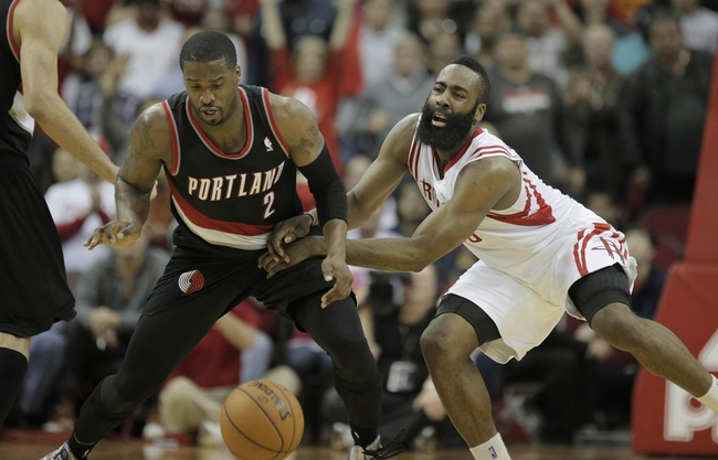 Mar 9, 2014; Houston, TX, USA; Portland Trail Blazers shooting guard Wesley Matthews (2) and Houston Rockets shooting guard James Harden (13) fight for the ball during the overtime period at Toyota Center. Mandatory Credit: Andrew Richardson-USA TODAY Sports