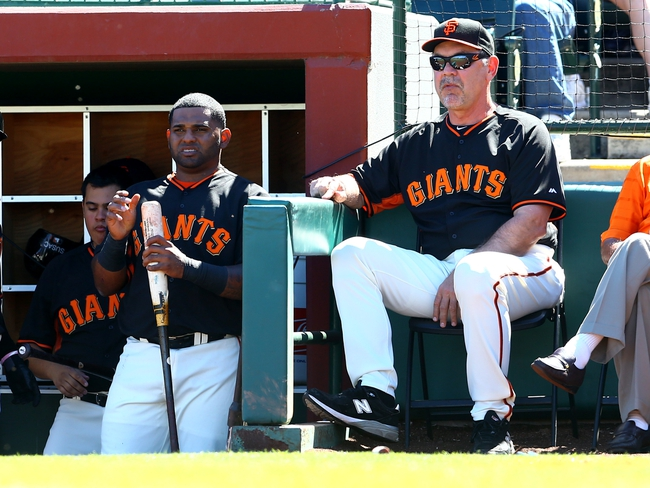 Mar 10, 2014; Scottsdale, AZ, USA; San Francisco Giants third baseman Pablo Sandoval (left) talks with manager Bruce Bochy during the game against the Chicago Cubs at Scottsdale Stadium. Mandatory Credit: Mark J. Rebilas-USA TODAY Sports