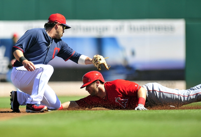 March 10, 2014; Goodyear, AZ, USA; Los Angeles Angels third baseman Andrew Romine (7) steals second against tag of the Cleveland Indians second baseman Jason Kipnis (22) in the first inning at Goodyear Ballpark. Mandatory Credit: -USA TODAY Sports