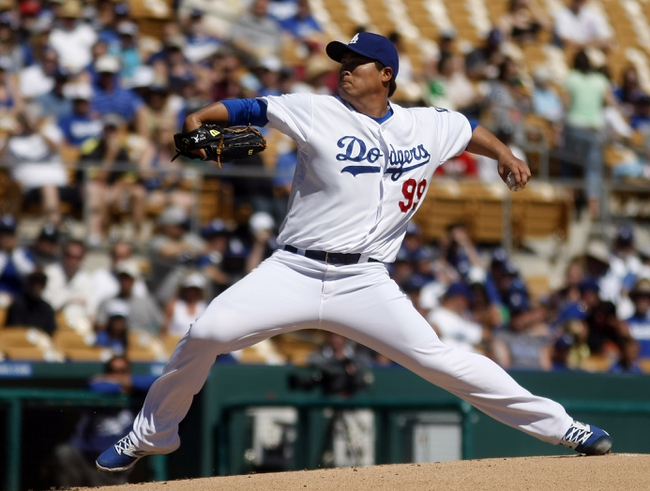 Mar 10, 2014; Phoenix, AZ, USA; Los Angeles Dodgers starting pitcher Hyun-Jin Ryu (99) throws in the first inning against the Oakland Athletics at Camelback Ranch. Mandatory Credit: Rick Scuteri-USA TODAY Sports