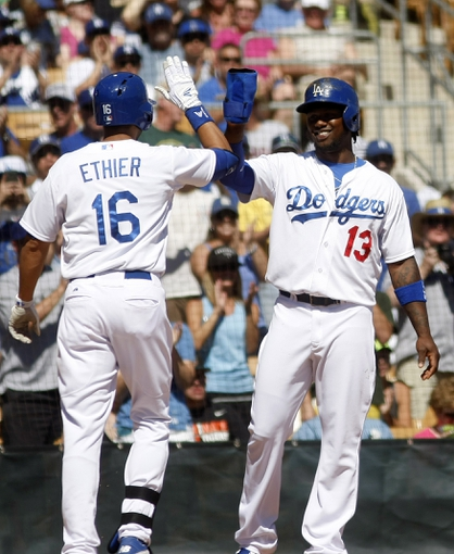 Mar 10, 2014; Phoenix, AZ, USA; Los Angeles Dodgers shortstop Hanley Ramirez (13) gives Andre Ethier (16) a high five after Ethier hit a three run home run in the first inning against the Oakland Athletics at Camelback Ranch. Mandatory Credit: Rick Scuteri-USA TODAY Sports