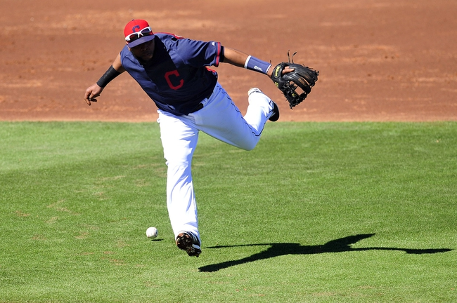 March 10, 2014; Goodyear, AZ, USA; Cleveland Indians third baseman Carlos Santana (41) misses fielding a hit in the third inning against the Los Angeles Angels at Goodyear Ballpark. Mandatory Credit: -USA TODAY Sports
