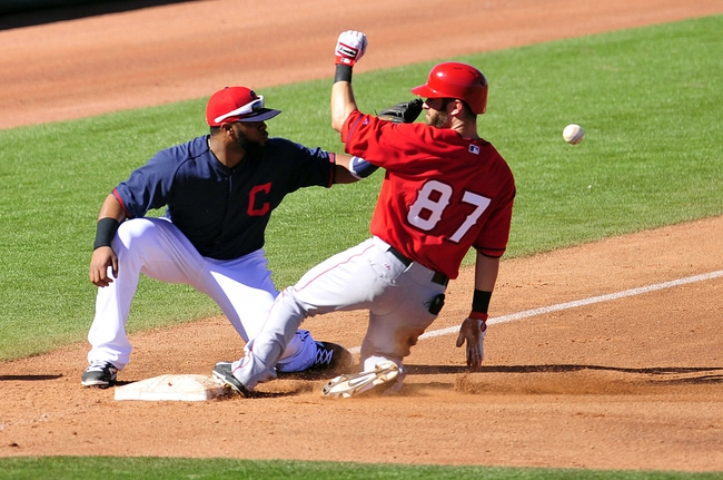 March 10, 2014; Goodyear, AZ, USA; Los Angeles Angels right fielder Matt Long (87) reaches third base on a triple against Cleveland Indians third baseman Carlos Santana (41) in the fifth inning at Goodyear Ballpark. Mandatory Credit: -USA TODAY Sports