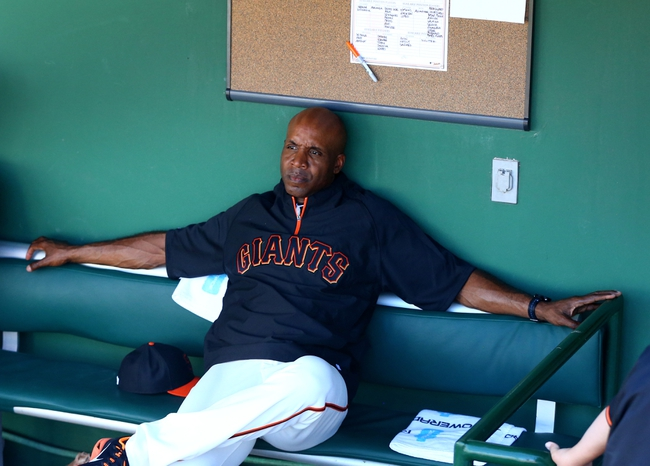 Mar 10, 2014; Scottsdale, AZ, USA; San Francisco Giants former outfielder Barry Bonds in the dugout during the game against the Chicago Cubs at Scottsdale Stadium. Mandatory Credit: Mark J. Rebilas-USA TODAY Sports