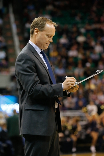 Mar 10, 2014; Salt Lake City, UT, USA; Atlanta Hawks head coach Mike Budenholzer writes on his white board during a time out against the Utah Jazz during the first quarter at EnergySolutions Arena. Mandatory Credit: Chris Nicoll-USA TODAY Sports