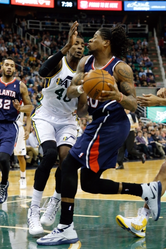 Mar 10, 2014; Salt Lake City, UT, USA; Atlanta Hawks small forward Cartier Martin (20) drives to the basket while being guarded by Utah Jazz small forward Jeremy Evans (40) during the second quarter at EnergySolutions Arena. Mandatory Credit: Chris Nicoll-USA TODAY Sports