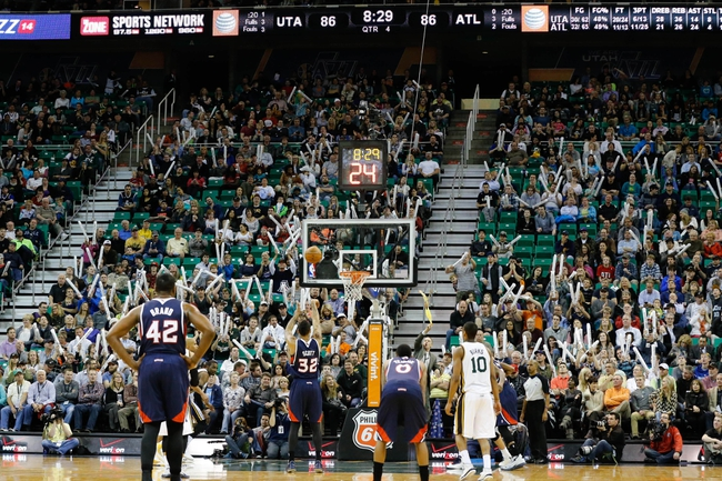 Mar 10, 2014; Salt Lake City, UT, USA; Atlanta Hawks power forward Mike Scott (32) shoots a foul shot while Utah Jazz fans try and distract Scott during the fourth quarter at EnergySolutions Arena. The Atlanta Hawks won the game 112-110. Mandatory Credit: Chris Nicoll-USA TODAY Sports