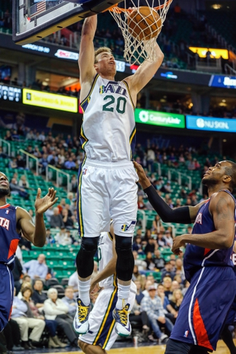 Mar 10, 2014; Salt Lake City, UT, USA; Utah Jazz shooting guard Gordon Hayward (20) dunks against the Atlanta Hawks during the fourth quarter at EnergySolutions Arena. The Atlanta Hawks won the game 112-110. Mandatory Credit: Chris Nicoll-USA TODAY Sports