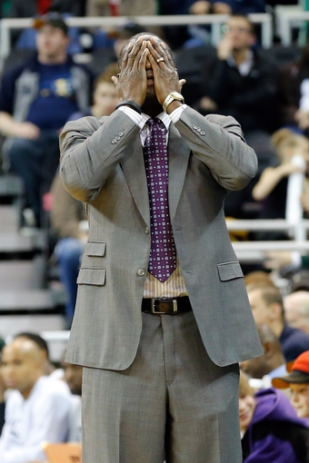 Mar 10, 2014; Salt Lake City, UT, USA; Utah Jazz head coach Tyrone Corbin covers his eyes after a foul was called on his team against the Atlanta Hawks during the fourth quarter at EnergySolutions Arena. The Atlanta Hawks won the game 112-110. Mandatory Credit: Chris Nicoll-USA TODAY Sports