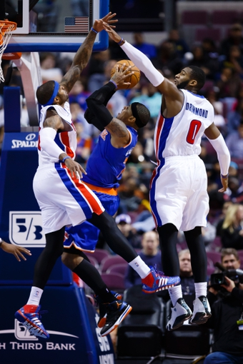 Nov 19, 2013; Auburn Hills, MI, USA; New York Knicks small forward Carmelo Anthony (7) shoots defended by Detroit Pistons small forward Josh Smith (6) and power forward Greg Monroe (10) at The Palace of Auburn Hills. Mandatory Credit: Rick Osentoski-USA TODAY Sports