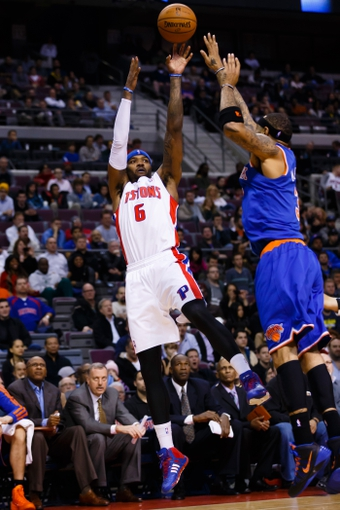 Nov 19, 2013; Auburn Hills, MI, USA; Detroit Pistons small forward Josh Smith (6) shoots on New York Knicks power forward Kenyon Martin (3) at The Palace of Auburn Hills. Mandatory Credit: Rick Osentoski-USA TODAY Sports