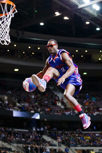Nov 19, 2013; Auburn Hills, MI, USA; Detroit Pistons Flight Crew member performs during a timeout in the second half against the New York Knicks at The Palace of Auburn Hills. Mandatory Credit: Rick Osentoski-USA TODAY Sports
