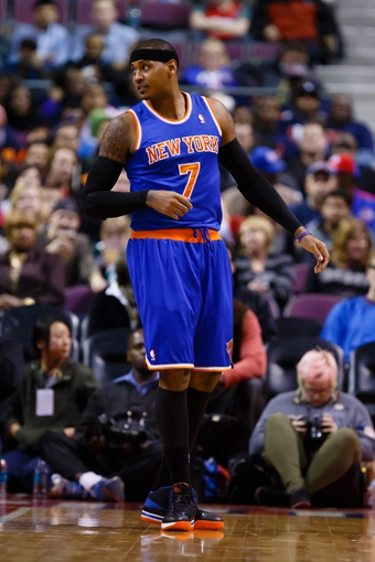 Nov 19, 2013; Auburn Hills, MI, USA; New York Knicks small forward Carmelo Anthony (7) during the game against the Detroit Pistons at The Palace of Auburn Hills. Mandatory Credit: Rick Osentoski-USA TODAY Sports