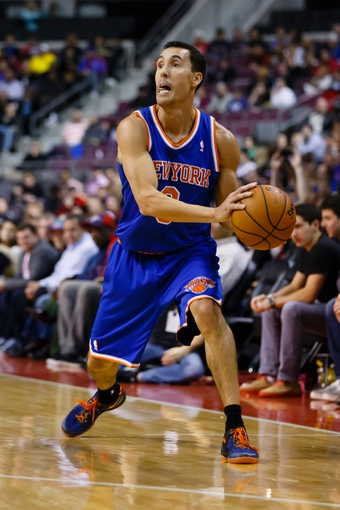 Nov 19, 2013; Auburn Hills, MI, USA; New York Knicks point guard Pablo Prigioni (9) moves the ball against the Detroit Pistons at The Palace of Auburn Hills. Mandatory Credit: Rick Osentoski-USA TODAY Sports
