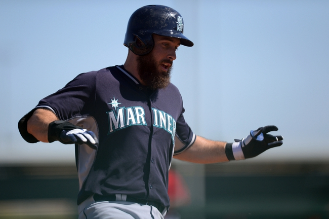 Mar 11, 2014; Tempe, AZ, USA; Seattle Mariners center fielder Dustin Ackley (13) rounds third base against the Los Angeles Angels at Tempe Diablo Stadium. Mandatory Credit: Joe Camporeale-USA TODAY Sports
