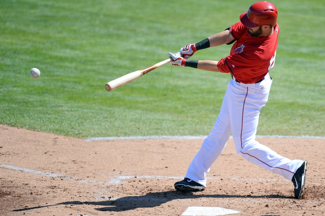 Mar 11, 2014; Tempe, AZ, USA; Los Angeles Angels outfielder Matt Long (87) hits an RBI single against the Seattle Mariners at Tempe Diablo Stadium. Mandatory Credit: Joe Camporeale-USA TODAY Sports