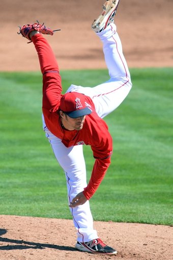 Mar 11, 2014; Tempe, AZ, USA; Los Angeles Angels starting pitcher C.J. Wilson (33) pitches against the Seattle Mariners at Tempe Diablo Stadium. Mandatory Credit: Joe Camporeale-USA TODAY Sports