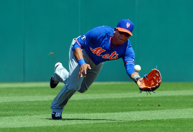 Mar 11, 2014; Jupiter, FL, USA; New York Mets center fielder Juan Lagares (12) makes a catch against the St. Louis Cardinals at Roger Dean Stadium. The Mets defeated the Cardinals 9-8. Mandatory Credit: Scott Rovak-USA TODAY Sports