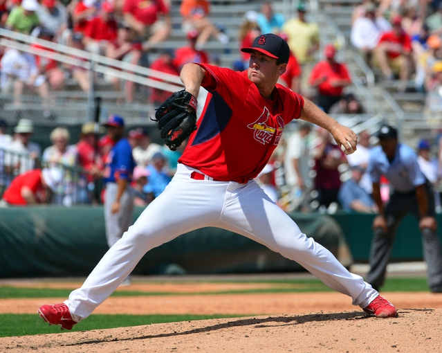 Mar 11, 2014; Jupiter, FL, USA; St. Louis Cardinals relief pitcher Tim Cooney (66) delivers a pitch against the New York Mets at Roger Dean Stadium. The Mets defeated the Cardinals 9-8. Mandatory Credit: Scott Rovak-USA TODAY Sports