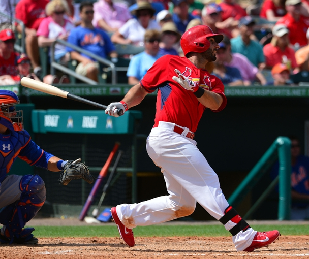 Mar 11, 2014; Jupiter, FL, USA; St. Louis Cardinals third baseman Daniel Descalso (33) hits a 2 run double against the New York Mets at Roger Dean Stadium. The Mets defeated the Cardinals 9-8. Mandatory Credit: Scott Rovak-USA TODAY Sports