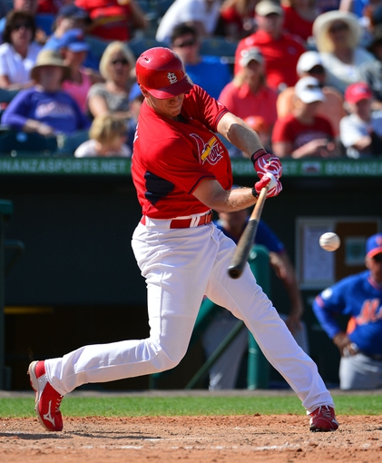 Mar 11, 2014; Jupiter, FL, USA; St. Louis Cardinals right fielder Stephen Piscotty (91) hits an rbi double against the New York Mets at Roger Dean Stadium. The Mets defeated the Cardinals 9-8. Mandatory Credit: Scott Rovak-USA TODAY Sports