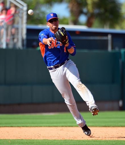 Mar 11, 2014; Jupiter, FL, USA; New York Mets third baseman Wilmer Flores (4) throws out a St. Louis Cardinals base runner at Roger Dean Stadium. The Mets defeated the Cardinals 9-8. Mandatory Credit: Scott Rovak-USA TODAY Sports