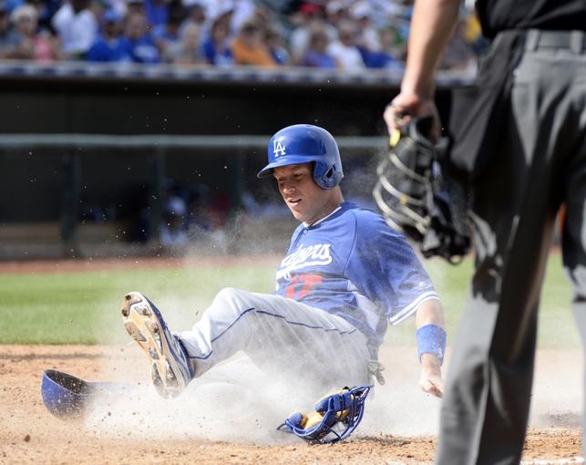 Mar 11, 2014; Surprise, AZ, USA;  Los Angeles Dodgers catcher AJ Ellis (17) scores during the seventh inning against the Kansas City Royals at Surprise Stadium. Mandatory Credit: Christopher Hanewinckel-USA TODAY Sports