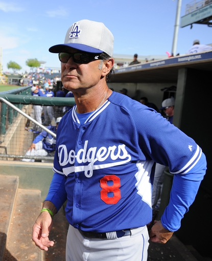 Mar 11, 2014; Surprise, AZ, USA;  Los Angeles Dodgers manager Don Mattingly (8) prior to the seventh inning against the Kansas City Royals at Surprise Stadium. Mandatory Credit: Christopher Hanewinckel-USA TODAY Sports