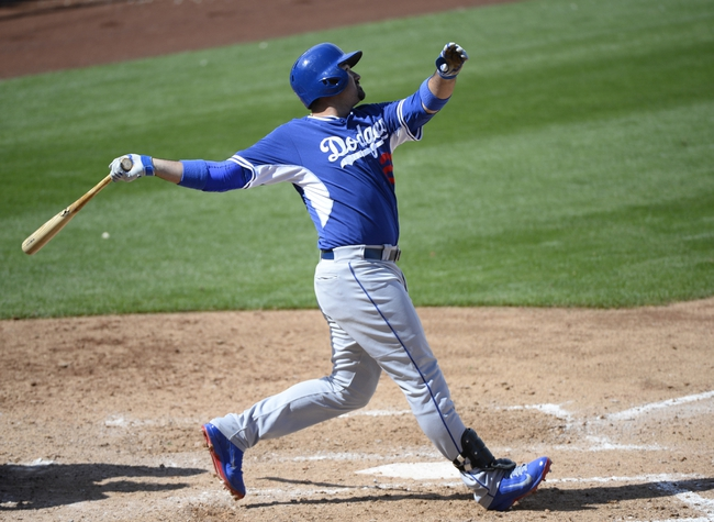 Mar 11, 2014; Surprise, AZ, USA; Los Angeles Dodgers first baseman Adrian Gonzalez (23) during an at bat in the fifth inning against the Kansas City Royals at Surprise Stadium. Mandatory Credit: Christopher Hanewinckel-USA TODAY Sports
