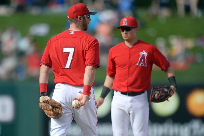 Mar 11, 2014; Tempe, AZ, USA; Los Angeles Angels third baseman Andrew Romine (7) reacts after bobbling the ball and preventing a force out at second base in the eighth inning against the Seattle Mariners at Tempe Diablo Stadium. Mandatory Credit: Joe Camporeale-USA TODAY Sports
