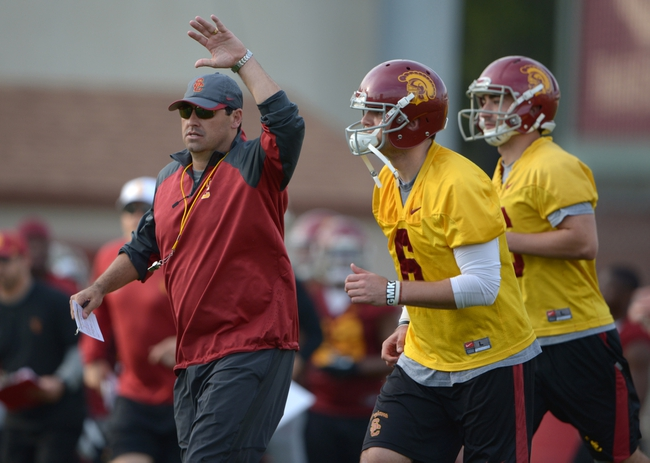 Mar 11, 2014; Los Angeles, CA, USA; Southern California Trojans coach Steve Sarkisian (left) and quarterbacks Cody Kessler (6) and Anthony Neyer (16) at spring practice at Howard Jones Field. Mandatory Credit: Kirby Lee-USA TODAY Sports