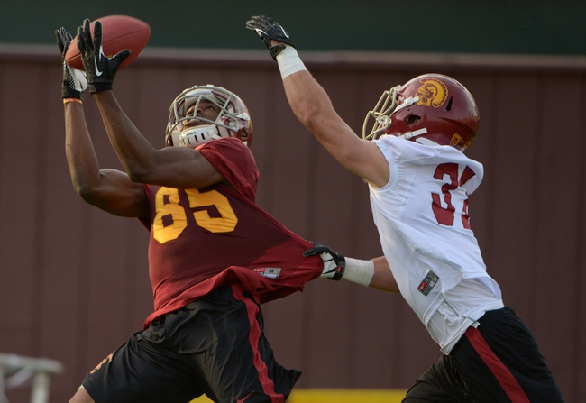 Mar 11, 2014; Los Angeles, CA, USA; Southern California Trojans receiver Victor Blackwell (85) is defended by safety Matt Lopes (37) at spring practice at Howard Jones Field. Mandatory Credit: Kirby Lee-USA TODAY Sports