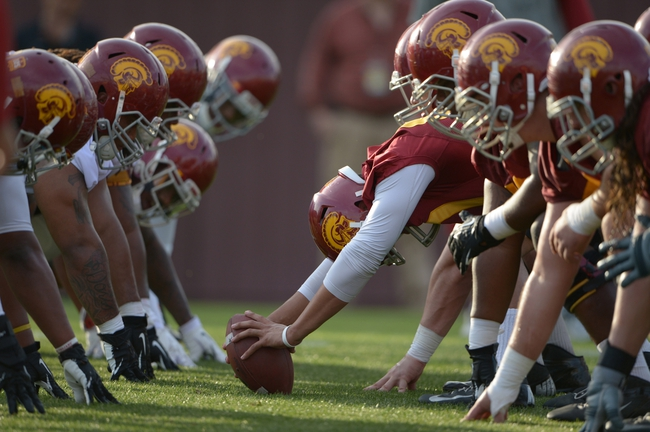 Mar 11, 2014; Los Angeles, CA, USA; General view of the line of scrimmage as Southern California Trojans snapper Zach Smith (60) snaps the ball at spring practice at Howard Jones Field. Mandatory Credit: Kirby Lee-USA TODAY Sports