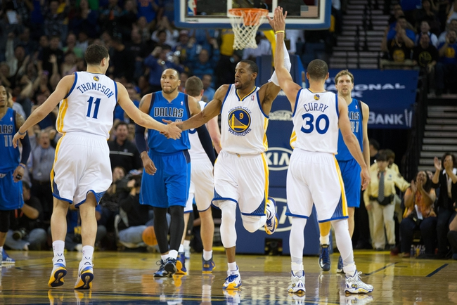 Mar 11, 2014; Oakland, CA, USA; Golden State Warriors forward Andre Iguodala (9) high fives guard Klay Thompson (11) and guard Stephen Curry (30) after a play against the Dallas Mavericks during the second quarter at Oracle Arena. Mandatory Credit: Kelley L Cox-USA TODAY Sports
