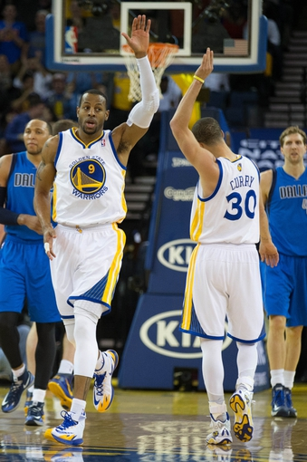 Mar 11, 2014; Oakland, CA, USA; Golden State Warriors forward Andre Iguodala (9) high fives guard Stephen Curry (30) after a play against the Dallas Mavericks during the second quarter at Oracle Arena. Mandatory Credit: Kelley L Cox-USA TODAY Sports