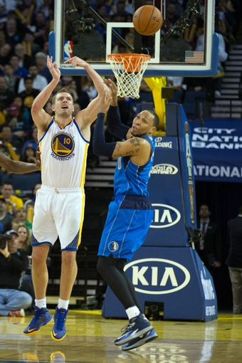 Mar 11, 2014; Oakland, CA, USA; Golden State Warriors forward David Lee (10) is fouled by Dallas Mavericks forward Shawn Marion (0) on a pass during the third quarter at Oracle Arena. The Golden State Warriors defeated the Dallas Mavericks 108-85. Mandatory Credit: Kelley L Cox-USA TODAY Sports