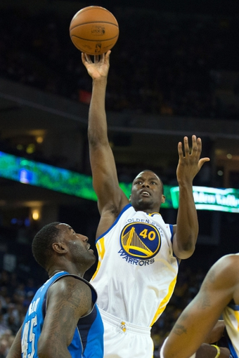 Mar 11, 2014; Oakland, CA, USA; Golden State Warriors forward Harrison Barnes (40) shoots the ball Dallas Mavericks during the third quarter at Oracle Arena. The Golden State Warriors defeated the Dallas Mavericks 108-85. Mandatory Credit: Kelley L Cox-USA TODAY Sports