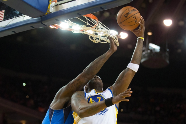 Mar 11, 2014; Oakland, CA, USA; Golden State Warriors center Jermaine O'Neal (7) is fouled by Dallas Mavericks center DeJuan Blair (45) on a shot during the third quarter at Oracle Arena. The Golden State Warriors defeated the Dallas Mavericks 108-85. Mandatory Credit: Kelley L Cox-USA TODAY Sports