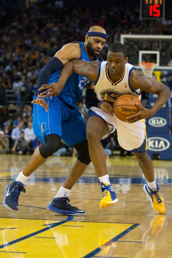 Mar 11, 2014; Oakland, CA, USA; Golden State Warriors forward Harrison Barnes (40) drives in against Dallas Mavericks center DeJuan Blair (45) during the fourth quarter at Oracle Arena. The Golden State Warriors defeated the Dallas Mavericks 108-85. Mandatory Credit: Kelley L Cox-USA TODAY Sports