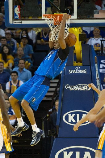 Mar 11, 2014; Oakland, CA, USA; Dallas Mavericks forward Brandan Wright (34) dunks the ball against the Golden State Warriors during the fourth quarter at Oracle Arena. The Golden State Warriors defeated the Dallas Mavericks 108-85. Mandatory Credit: Kelley L Cox-USA TODAY Sports