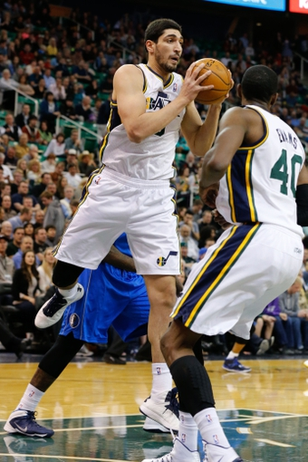 Mar 12, 2014; Salt Lake City, UT, USA; Utah Jazz center Enes Kanter (0) grabs a rebound against the Dallas Mavericks during the second quarter at EnergySolutions Arena. Mandatory Credit: Chris Nicoll-USA TODAY Sports