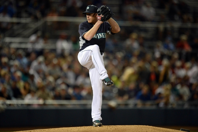 Mar 12, 2014; Peoria, AZ, USA; Seattle Mariners starting pitcher Randy Wolf (28) pitches in the first inning against the Chicago Cubs at Peoria Sports Complex. Mandatory Credit: Joe Camporeale-USA TODAY Sports