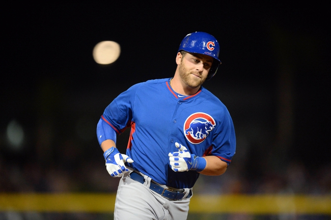 Mar 12, 2014; Peoria, AZ, USA; Chicago Cubs first baseman Mike Olt (30) runs the bases after hitting a home run in the second inning against the Seattle Mariners at Peoria Sports Complex. Mandatory Credit: Joe Camporeale-USA TODAY Sports