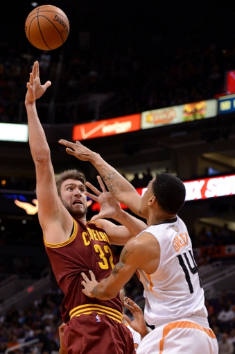 Mar 12, 2014; Phoenix, AZ, USA; Cleveland Cavaliers center Spencer Hawes (32) shoots the ball as Phoenix Suns guard Gerald Green (14) defends in the first half at US Airways Center. Mandatory Credit: Jennifer Stewart-USA TODAY Sports