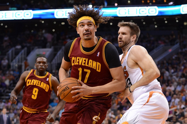 Mar 12, 2014; Phoenix, AZ, USA; Cleveland Cavaliers center Anderson Varejao (17) holds the ball as the Phoenix Suns forward Shavlik Randolph (43) defends in the first half at US Airways Center. Mandatory Credit: Jennifer Stewart-USA TODAY Sports