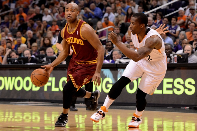 Mar 12, 2014; Phoenix, AZ, USA; Cleveland Cavaliers guard Jarrett Jack (1) dribbles the ball around Phoenix Suns guard Eric Bledsoe (2) in the first half at US Airways Center. Mandatory Credit: Jennifer Stewart-USA TODAY Sports